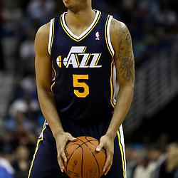 April 11, 2011; New Orleans, LA, USA; Utah Jazz point guard Devin Harris (5) against the New Orleans Hornets during a game at the New Orleans Arena. The Jazz defeated the Hornets 90-78.  Mandatory Credit: Derick E. Hingle