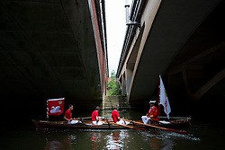 © Licensed to London News Pictures. 20/07/2015. David Barber, The Queen's Swan Marker passes underneath a bridge.Swan Upping takes place on the River Thames near Windsor, Berkshire, UK. The annual event dates from medieval times, when The Crown claimed ownership of all mute swans which were considered an important food source for banquets and feasts. Today, the cygnets are weighed and measured to obtain estimates of growth rates and the birds are examined for any sign of injury, commonly caused by fishing hook and line. The cygnets are ringed with individual identification numbers by The Queen's Swan Warden, whose role is scientific and non-ceremonial. The Queen's Swan Marker produces an annual report after Swan Upping detailing the number of swans, broods and cygnets counted during the week. Photo credit: Ben Cawthra/LNP