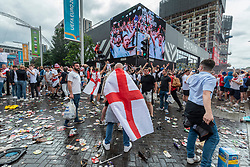 © Licensed to London News Pictures. 11/07/2021. LONDON, UK. Discarded beer cans on the road as England fans gather outside Wembley Stadium ahead of the final of Euro 2020 between Italy and England.  It is the first major final that England will have played in since winning the World Cup in 1966 and Italy remain unbeaten in their last 33 matches.  Photo credit: Stephen Chung/LNP