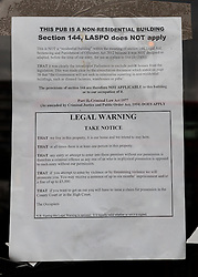 "© Licensed to London News Pictures. 19/06/2015. London, UK. A legal notice stating occupation and ""squatters rights"" of the Elephant and Castle pub in Southwark, south-east London. A group of activists have occupied the Elephant and Castle pub and are squatting in it to prevent Foxtons Estate Agents from opening an Estate Agent branch. The activists, who are against gentrification want the historic pub site to become a community asset with open use. The Elephant and Castle pub closed earlier this year after its license was revoke and in April, representatives of Foxtons notified planning authorities that they intend to open a branch of the estate agents chain in the pub. Photo credit : Vickie Flores/LNP"