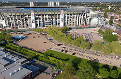 © Licensed to London News Pictures. 31/05/2021. London, UK. Long lines of people form a queue snaking around the car park of England's biggest vaccine centre at Twickenham Stadium in south west London after the centre said they will vaccinate anyone over the age of 18 today up to 7:30pm. . Photo credit: Peter Macdiarmid/LNP