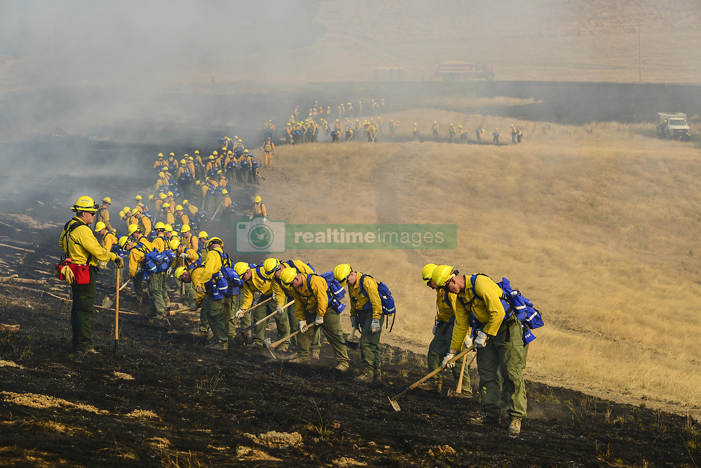 August 28, 2017 - Salem, Oregon, U.S. - Oregon Army National Guardsmen check for hot spots during a firefighting training exercise in Salem, Oregon. Nearly 125 soldiers from the 41st Infantry Brigade Combat Team volunteered for the exercise. (Credit Image: ? April Davis/National Guard via ZUMA Wire)