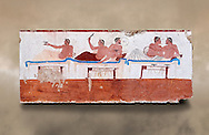 """Greek Fresco on the inside of Tomb of  the Diver  [La Tomba del Truffatore]. This panel is from one of the long sides of the tomb and shows a symposium of men lying on couches facing low tables on which goblets have been placed.  The abondon experienced at the Synposium was one way in which the dead could access the next world . The tomb is painted with the true fresco technique and its importance lies in being """"the only example of Greek painting with figured scenes dating from the Orientalizing, Archaic, or Classical periods to survive in its entirety. Paestrum, Andriuolo.  (480-470 BC  ) .<br /> <br /> If you prefer to buy from our ALAMY PHOTO LIBRARY  Collection visit : https://www.alamy.com/portfolio/paul-williams-funkystock - Scroll down and type - Paestum Fresco - into LOWER search box. {TIP - Refine search by adding a background colour as well}.<br /> <br /> Visit our ANCIENT GREEKS PHOTO COLLECTIONS for more photos to download or buy as wall art prints https://funkystock.photoshelter.com/gallery-collection/Ancient-Greeks-Art-Artefacts-Antiquities-Historic-Sites/C00004CnMmq_Xllw"""