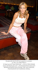 Model LISA BUTCHER at a party in London on 9th July 2002.	PBW 9