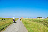 Tourists on coastal bicycle ride on carless island of Juist, Wadden sea national park, Germany