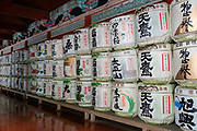 """The decorative white round empty liquor barrels at Japanese shrines are kazaridaru, shrine offerings from Japan's nihonshu makers. In Japanese, the word sake (""""liquor"""", also pronounced shu) can refer to any alcoholic drink, while the beverage called """"sake"""" in English is usually termed nihonshu (""""Japanese liquor"""" or Japanese rice wine). In traditional Japanese culture, nihonshu is believed to connect people directly to the gods, as in Shinto ceremonies at weddings, during New Year celebrations and at many festivals. In modern times the kazaridaru are usually offered empty, with the nihonshu maker also providing one bottle of their best rice wine as part of the offering. The offering is a form of prayer for bountiful harvests of rice, and also honours the shrine's local deity. The kanji on the decorative barrels indicate the maker's name and location. Toshogu Shrine is the final resting place of Tokugawa Ieyasu, the founder of the Tokugawa Shogunate that ruled Japan for over 250 years until 1868. Initially a relatively simple mausoleum, Toshogu was enlarged into the spectacular complex seen today by Ieyasu's grandson Iemitsu during the first half of the 1600s. Toshogu is part of Shrines and Temples of Nikko UNESCO World Heritage site."""