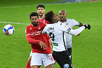 Football - 2020 / 2021 Sky Bet Championship - Swansea City vs Nottingham Forest - Liberty Stadium<br /> <br /> Jamal Lowe Swansea challenged by Cyrus Christie of Nottingham Forest<br /> <br /> <br /> COLORSPORT/WINSTON BYNORTH