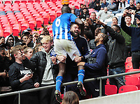 Football - 2019 Buildbase FA Vase Final - Chertsey Town vs. Cray Valley Paper Mills<br /> <br /> Man of the match Jake Rowe of Chertsey celebrates after the match with the fans, at Wembley Stadium.<br /> <br /> COLORSPORT/ANDREW COWIE
