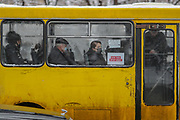 People some of them wearing surgical face protective mask to curb the spread of coronavirus outbreak in Armenia sits in a bus as they are seen through a misty glass of the public transport in the Armenian capital Yerevan on Wednesday, Jan 20, 2021. According to John Hopkins University, Coronavirus death rates in Armenia reached up to 164,912 with over 3,000 deaths. (Photo/ Vudi Xhymshiti)
