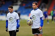 Ian Henderson and Grant Holt wear Team Ellis t-shirts in support of ex academy payer Ellis Robinson recently paralysed during the Sky Bet League 1 match between Oldham Athletic and Rochdale at Boundary Park, Oldham, England on 19 March 2016. Photo by Daniel Youngs.