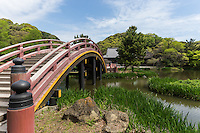 """Shomyoji Arched Bridge. Shomyoji was built by Sanetoki Hojo during the Kamakura period, and was made the Hojo family temple of the Kanazawa area. The Jodo style garden with Ajiike Pond in front of the main temple is its most unique feature when considering the arched bridge. The temple's bell was portrayed in the woodblock print """"Shomyo-no-Bansho,"""" one of eight prints depicting views of Kanazawa by Hiroshige Utagawa."""