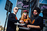 """The Improverts share a deep fried Mars bar for their """"Welcome to Edinburgh"""" postcards."""