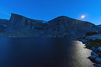 The Lost Twin Lakes are found at 10,300 feet  in the Cloud Peak Wilderness. A 6 mile hike from the West Tensleep Lake trailhead, it's the perfect spot for an overnight backpacking trip. The two lakes are in a glacial cirque surrounded by massive granite cliffs up to 2,000 feet high. The light from the crescent moon was sparkling in the lake before it set. The planet Jupiter can also be seen just below the moon.