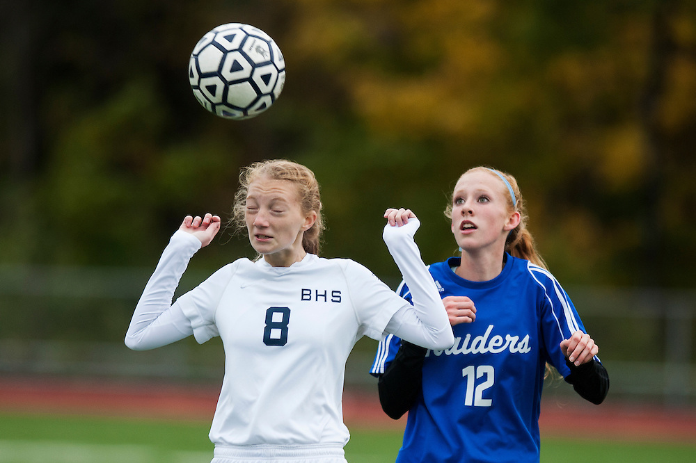 Burlington's Lucy Hines (8) heads the ball as U-32's Cilla Wanzer (12) looks on during the girls playoff soccer game between the U-32 Raiders and the Burlington Sea Horses at Buck Hard Field on Friday afternoon October 24, 2014 in Burlington, Vermont (BRIAN JENKINS, for the Free Press)