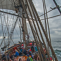 Tourists sail aboard a recreated 19th Century brig called Lady Washington. The ship is owned by a foundation that focuses on educating school children about sailing and the sea.