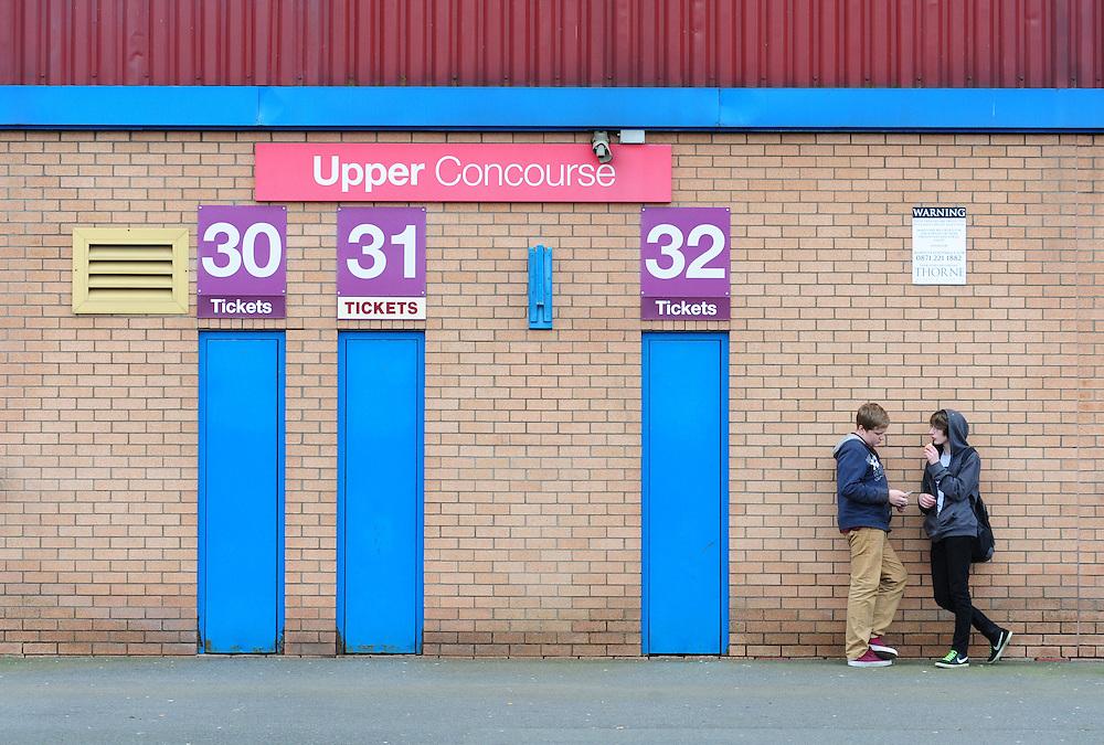Burnley fans outside the ground<br /> <br /> Photo by Chris Vaughan/CameraSport<br /> <br /> Football - The Football League Sky Bet Championship - Burnley v Middlesbrough - Saturday 12th April 2014 - Turf Moor - Burnley<br /> <br /> © CameraSport - 43 Linden Ave. Countesthorpe. Leicester. England. LE8 5PG - Tel: +44 (0) 116 277 4147 - admin@camerasport.com - www.camerasport.com