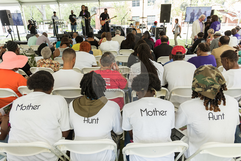 Family members of Rev. Depayne Middleton-Doctor, killed in the Mother Emanuel African Methodist Episcopal Church shooting wear shirts with their relationship to the slain pastor during a memorial service marking the 2nd anniversary of the mass shooting June 17, 2017 in Charleston, South Carolina. Nine members of the historic African-American church were gunned down by a white supremacist during bible study on June 17, 2015.
