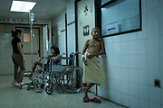 2016/05/29 - Barcelona, Venezuela: Jose awaits for his turn to have a shower in the corridor of children wing in Dr. Luis Razetti hospital, Barcelona, Venezuela. (Eduardo Leal)