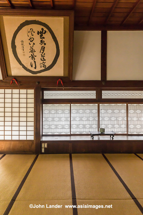 Tatami Room and Shoji -  In traditional Japanese architecture, a shoji is a door, window or room divider made of translucent paper over a frame of wood or bamboo. While washi is the traditional paper, shoji can also be made of modern paper.  Shoji doors are designed to slide open, and conserve space that would be required by a swinging door.  Shoji also provide a form of insulation in winter, keeping drafts out.  They are used in traditional houses in the washitsu or Japanese-style tatami room and almost all temples would have them in abundant use.  Shoji paper needs to be changed regularly as they collect dust and become discolored over time.  Normally this is done in late autumn each year.  However, modern Japanese will only change the shoji paper when they become too discolored for comfort, or have holes appearing in them.  It is a long, tedious process that most people wish to avoid.