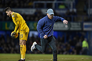 A supporter invades the pitch during the EFL Sky Bet League 1 match between Portsmouth and Northampton Town at Fratton Park, Portsmouth, England on 30 December 2017. Photo by Adam Rivers.