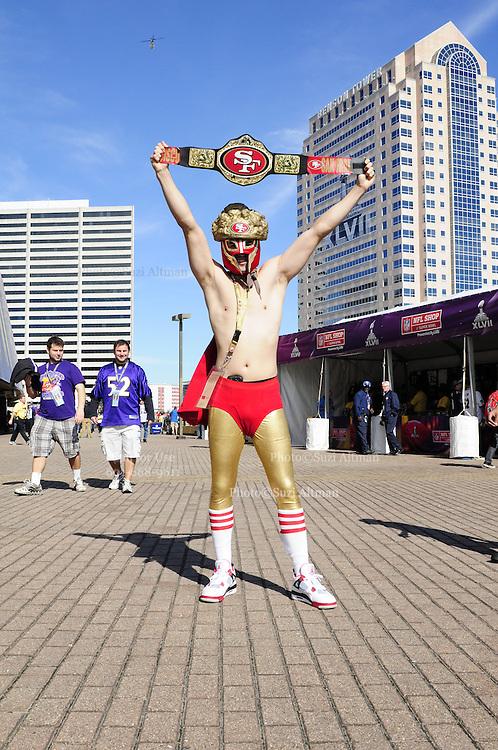 2/3/13 New Orleans LA.-NFL San Francisco 49er's fan Long Hong, of San Jose CA. 34, poses outside the Mercedes Benz Super Dome before  Super Bowl XLV11. The Francisco 49er's take on the Baltimore Ravens Sunday Feb. 3, 2013Photo©Suzi Altman