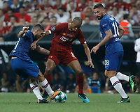 ISTANBUL, TURKEY - AUGUST 14: Joel Matip (C) of Liverpool vies for the ball with Mateo Kovacic (L) and Olivier Giroud of Chelsea during the UEFA Super Cup match between Liverpool and Chelsea at Vodafone Park on August 14, 2019 in Istanbul, Turkey. (Photo by MB Media/Getty Images)