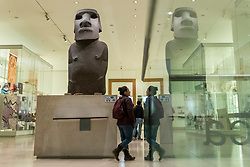 "© Licensed to London News Pictures. 21/11/2018. LONDON, UK.  A members of the public walks by the Hoa Hakananai'a (""Stolen or Hidden Friend"") at the British Museum.  The four-tonne statue, or ""moai"", one of hundreds originally found on Easter Island, has been on display in the museum for 150 years, after it was taken without permission in 1868 by the British naval captain Richard Powell, and given to Queen Victoria.  Tarita Alarcon Rapu, the governor of Easter Island, has demanded that the statue be returned to the island and to the indigenous people, the Rapa Nui.  Photo credit: Stephen Chung/LNP"