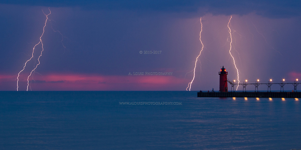 """Multiple lightning strikes captured of the South Haven lighthouse.  This image is natively a 10x20"""" panoramic print and is recommended for metallic paper."""
