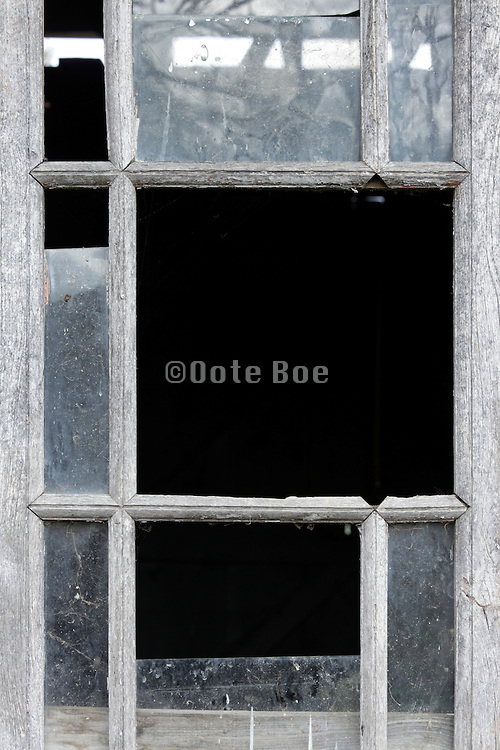 broken window in a abandoned shed