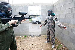 Avi Mayol, the Chairman of the International Krav Maga Federation (IKMF), takes students on day two on the Train & Travel in Israel, on Saturday 1st Jan 2011, at the Olympic shooting academy. The students practised gun defenses with real paintball guns for added realism. Train & Travel is a unique ten day program designed for IKMF's instructors, students & guests, interested in combining Krav Maga training with a tour of the holy land. Saturday 1st Jan 2011 at the Olympic shooting academy..©2011 Michael Schofield. All Rights Reserved.