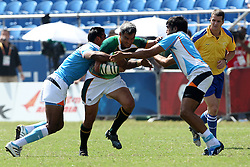 Neil Powell is caught in the tackle during the XIX Commonwealth Games 7s rugby match between South Africa and India held at The Delhi University in New Delhi, India on the  11 October 2010..Photo by:  Ron Gaunt/photosport.co.nz