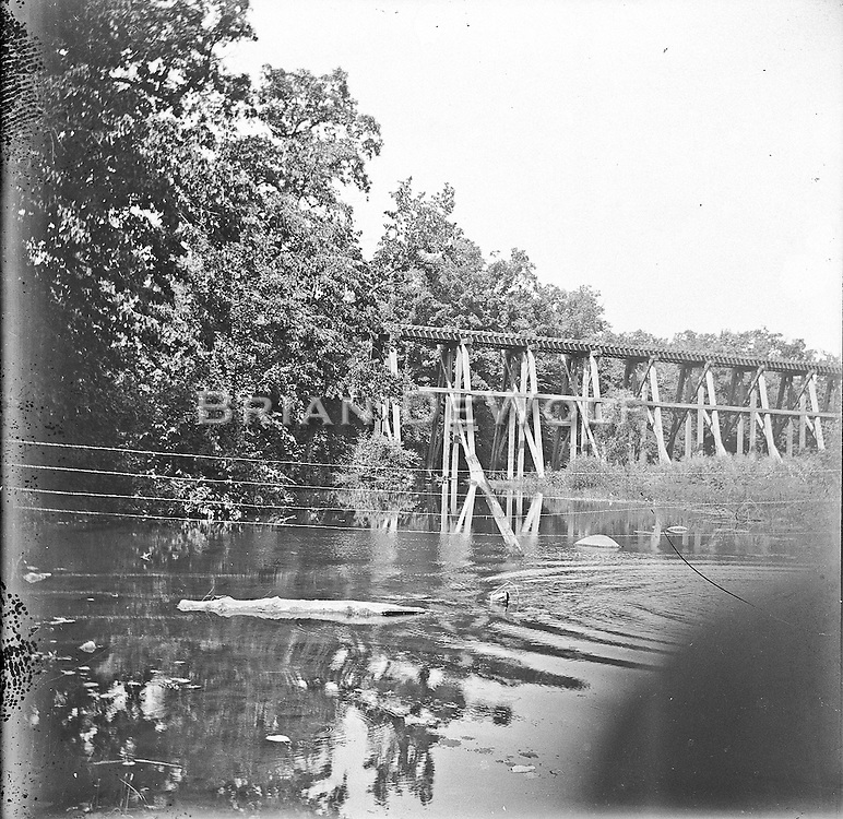 Originally thought to be the trestle near Clark Island and the water treatment facility, it has been identified as being the trestle over Mill Creek on the north end of the Mooseheart property. Thank you local historians for identifying it.