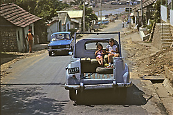 Two Children In Back Of Truck