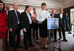 """DUP leader Arlene Foster, with MP's, speaking at the Stormont Hotel in Belfast after Prime Minister Theresa May has announced that she will work with """"friends and allies"""" in the DUP to enable her to lead a government."""