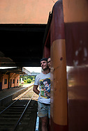 Two people visiting Sri Lanka from France ride a train between the cities of Colombo and Kandy. (April 1, 2017)