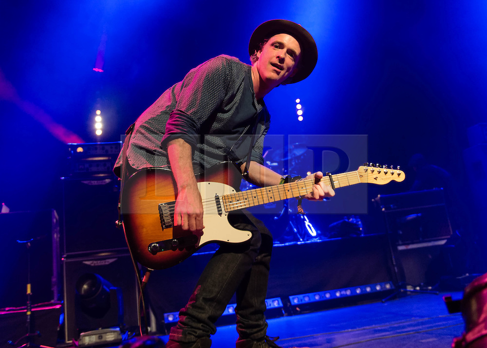 © Licensed to London News Pictures. 24/10/2013. London, UK.   Travis performing live at The Roundhouse. Travis are a Scottish post-Britpop alternative rock band formed in Glasgow in 1990, comprising Fran Healy (lead vocals, rhythm guitar), Dougie Payne (bass guitar, backing vocals), Andy Dunlop (lead guitar, banjo, backing vocals) and Neil Primrose (drums, percussion).  Photo credit : Richard Isaac/LNP
