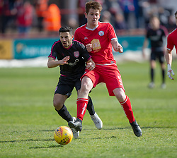 Arbroath's Omar Kader and Brechin City's Dougie Hill. Brechin City 1 v 1 Arbroath, Scottish Football League Division One played 13/4/2019 at Brechin City's home ground Glebe Park. Arbroath win promotion.