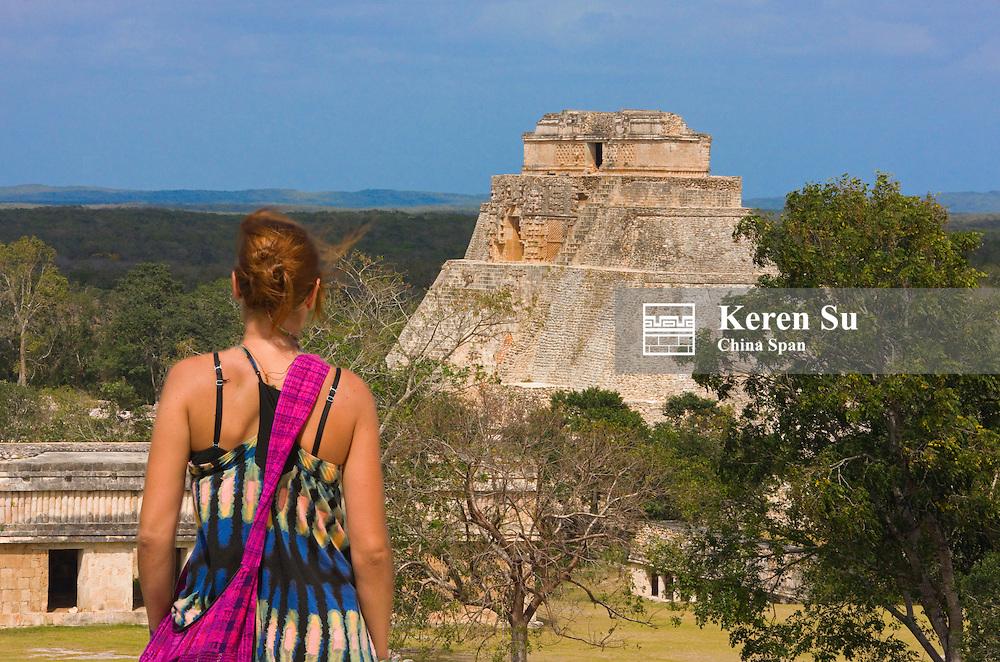 Tourist with The Magician Pyramid, Uxmal, Yucatan, Mexico