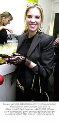 Society girl MISS ALEXANDRA AITKEN, at an exhibition in London on 24th October 2001.OTK 14