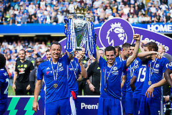 Retiring captain John Terry and Cesar Azpilicueta lift the trophy as Chelsea celebrate winning the 2016/17 Premier League - Rogan Thomson/JMP - 21/05/2017 - FOOTBALL - Stamford Bridge - London, England - Chelsea v Sunderland - Premier League..