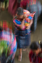 People moving through Indoor produce market, Chichicastenango, Guatemala