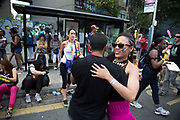 A guy and a girl break off to waltz together on Monday on 28th August 2016 at the 50th Notting Hill Carnival in West London. A celebration of West Indian / Caribbean culture and Europes largest street party, festival and parade. Revellers come in their hundreds of thousands to have fun, dance, drink and let go in the brilliant atmosphere. It is led by members of the West Indian / Caribbean community, particularly the Trinidadian and Tobagonian British population, many of whom have lived in the area since the 1950s. The carnival has attracted up to 2 million people in the past and centres around a parade of floats, dancers and sound systems.