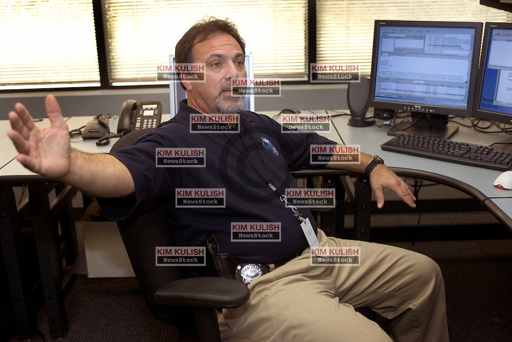Det. Kevin Fagaldie uses various software tools to recover evidence from data files accessed at his workstation at the Silicon Valley Regional Computer Forensics Lab.  Officials with the FBI and local law enforcement unveiled and gave a behind the scenes look at their new multi-million dollar facility in the heart of silicon valley.  The lab recovers digital evidence in a way that is legally acceptable to the courts.  A recent case of Missouri  woman accused of cutting a fetus from her victim was solved by a digital forensics team  tracking down internet messages on a computer.--Photo ©2005  by Kim Kulish