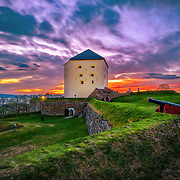 www.aziznasutiphotography.com                   Kristiansten Fortress<br /> Kristiansten festning<br /> Trondheim, Norway<br /> Kristiansten Fortress Trondheim 2009 1.JPG<br /> Site information<br /> Controlled byNorway<br /> Site history<br /> Built1681-1685<br /> Built byJohan Caspar von Cicignon and<br /> Anthony Coucheron<br /> In use1685-1816<br /> Battles/warsSwedish invasion 1718<br /> Kristiansten Fortress (Norwegian: Kristiansten Festning, historically spelled Christiansten) is located on a hill east of the city of Trondheim in Sør-Trøndelag county, Norway. It was built after the city fire of Trondheim in 1681 to protect the city against attack from the east. Construction was finished in 1685. It fulfilled its purpose in 1718 when Swedish forces laid siege against Trondheim. The fortress was decommissioned in 1816 by king Charles XIV John.
