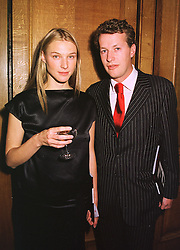 The HON ORLANDO & MRS MONTAGU, son of the Earl of Sandwich, at an exhibition in London on 14th September 1998.MJZ 46