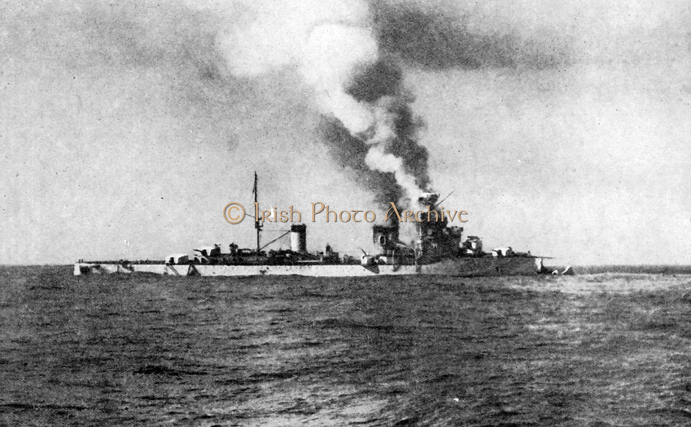 First full naval engagement  between British and Italian warships. Italy's most powerful cruiser 'Bartolemeo Colleoni' lying disabled, her bow shot away by fire from HMAS 'Sydney'.