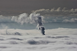 Clouds of vapour from a factory near Stirling rises through the morning mist..Pic ©2010 Michael Schofield. All Rights Reserved.