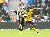 Football - 2019 / 2020 Premier League - Newcastle United vs. Arsenal<br /> <br /> Ainsley Maitland-Niles of Arsenal vies with Matt Ritchie of Newcastle United, at St James' Park.<br /> <br /> COLORSPORT/BRUCE WHITE