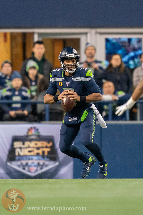 December 29, 2019; Seattle, Washington, USA; Seattle Seahawks quarterback Russell Wilson (3) during the second quarter against the San Francisco 49ers at CenturyLink Field.