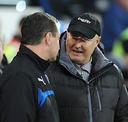 Cardiff City Manager, Russell Slade speaks to Colchester United Manager, Tony Humes - Photo mandatory by-line: Dougie Allward/JMP - Mobile: 07966 386802 - 02/01/2015 - SPORT - football - Cardiff - Cardiff City Stadium - Cardiff City v Colchester United - FA Cup - Third Round